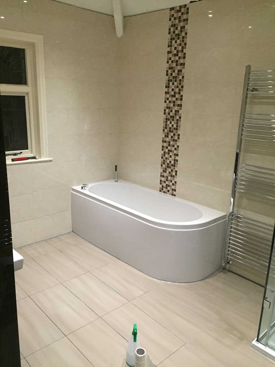 New tiled and fitted bathroom